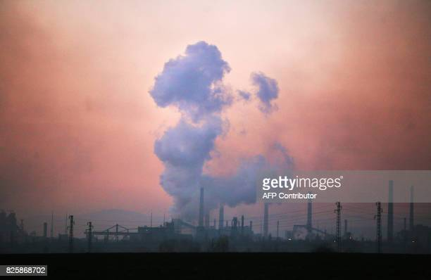 This 30 December 2006 file photo shows chimneys of the the largest steelmaker in the Balkans'Kremikovtzi' during sunset near the Bulgarian capital...