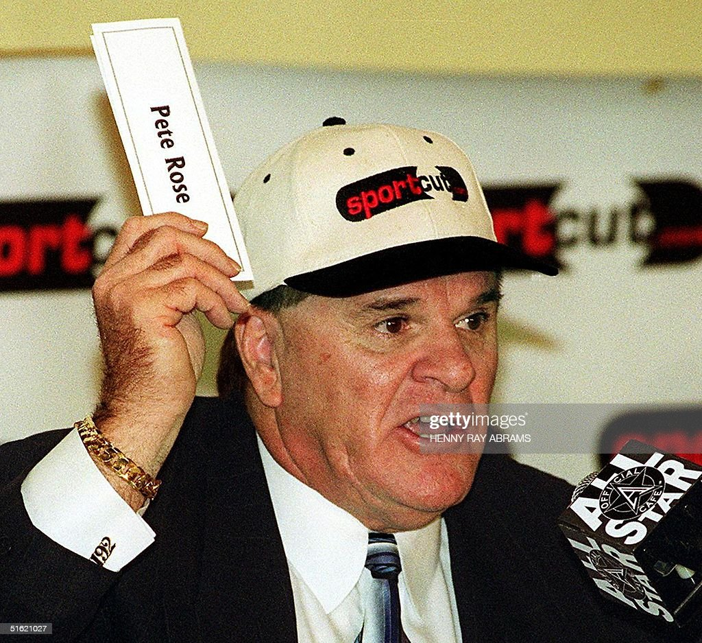 This 30 November 1999 file photo in New York shows former Cincinnati Reds player and manager Pete Rose, who was banned from the game in 1989 for allegedly gambling on baseball, uses his name tag to make a point about a petition which he launched on the Internet designed to convince Major League Baseball that he be reinstated and allowed to participate in baseball. In an interview to be broadcast 08 January 2004 by ABC News, Rose ends 15 years of denials by admitting he bet on baseball games in 1987 and 1988. His admission, considered a first step towards his reinstatement in baseball and a possible entry into the Baseball Hall of Fame, is expected to feature heavily in his new autobiography, My Prison Without Bars, which will be released 08 January 2004. AFP PHOTO/Henny Ray ABRAMS