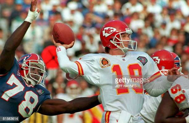 This 30 October 94 file photo shows Kansas City Chiefs quarterback Joe Montana preparing to pass against the rush of Buffalo Bills Bruce Smith in...