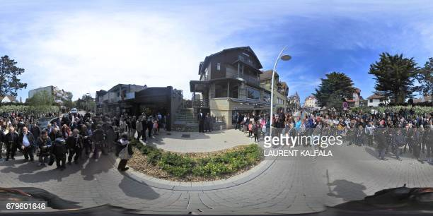 This 360 image shows people and journalists gathered in front of the home of French presidential election candidate for the En Marche movement...