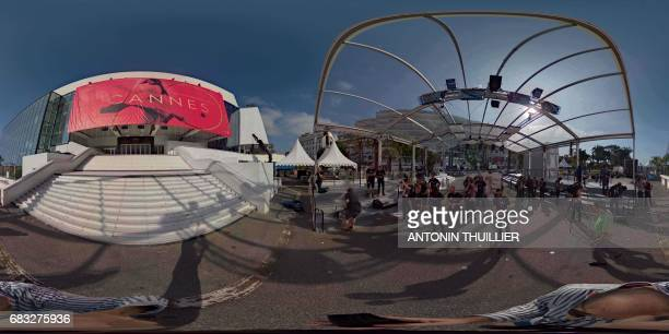 This 360 image shows photographers looking at the official poster of the 70th Cannes Film Festival on May 15 2017 on the facade of the Palais des...