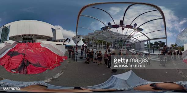 This 360 image shows photographers looking at the official poster of the 70th Cannes Film Festival laying on the stairs on May 15 2017 on the facade...