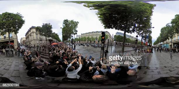 This 360 image shows supporters greeting the motorcade of the new French president Emmanuel Macron on the Champs Elysee after the handover ceremony...