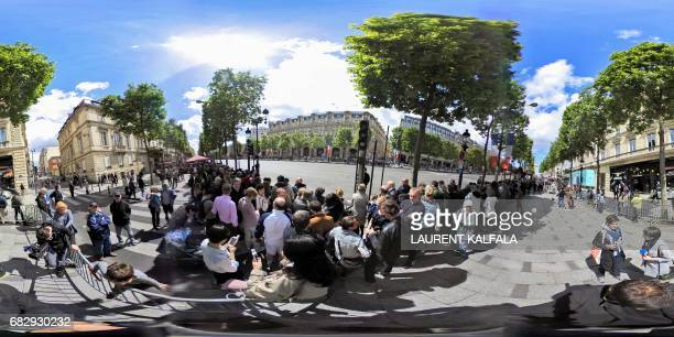 This 360 image shows supporters waiting under the sun to greet the new French president Emmanuel Macron on the Champs Elysee after the handover...