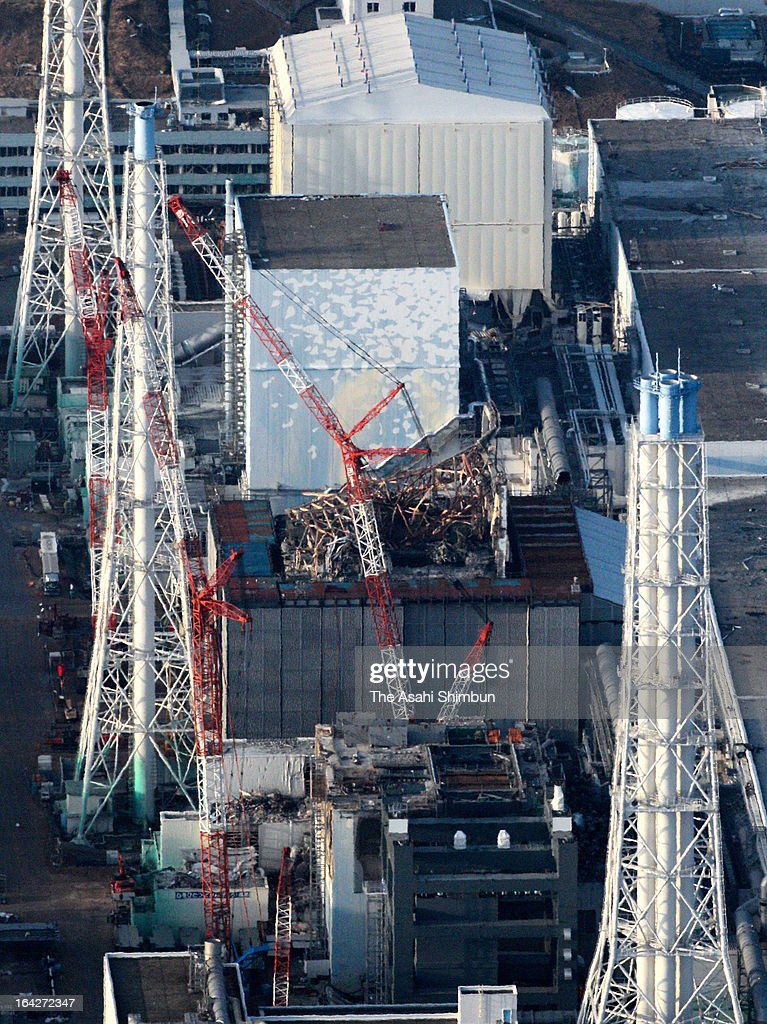 This aerial image shows (from top) No.1, No.2, No.3 and No.4 reactors of the Fukushima Daiichi Nuclear Power Plant during the power outage on March 19, 2013 in Okuma, Fukushima, Japan.
