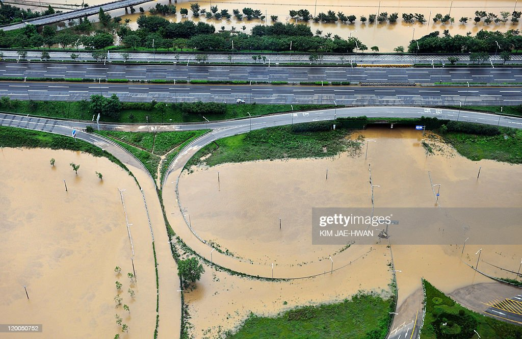 This aerial image shows roadways along the Han River in Seoul partially submerged under muddy waters on July 28, 2011 after the capital was pummeled by record rainfall on July 27. Tens of thousands of South Korean troops joined a massive clean-up after record-breaking rainfall killed at least 39 people, flooded hundreds of homes and turned main roads into muddy rivers.