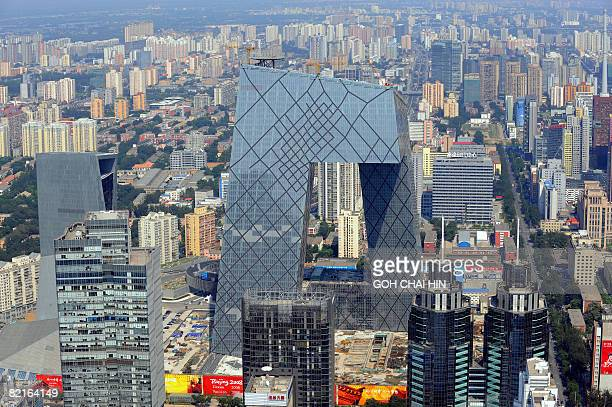 This aerial photo shows the CCTV headquarters building in Beijing on August 2 2008 ahead of the Beijing 2008 Olympic Games Costing some 800 million...