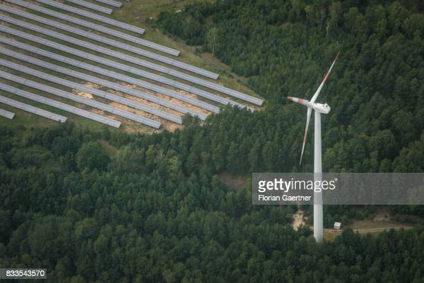 This aerial photo shows wind power station next to a solar fields on August 04 2017 in Bernsdorf Germany