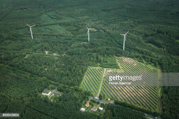 This aerial photo shows wind power stations next to a solar fields on August 04 2017 in Bernsdorf Germany