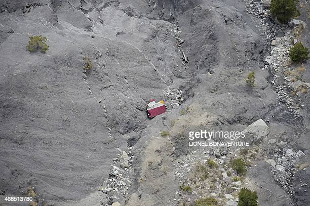 This aerial photo taken from a helicopter on April 3 2015 shows debris and a piece of the plane's stabilizer at the crash site of the Germanwings...