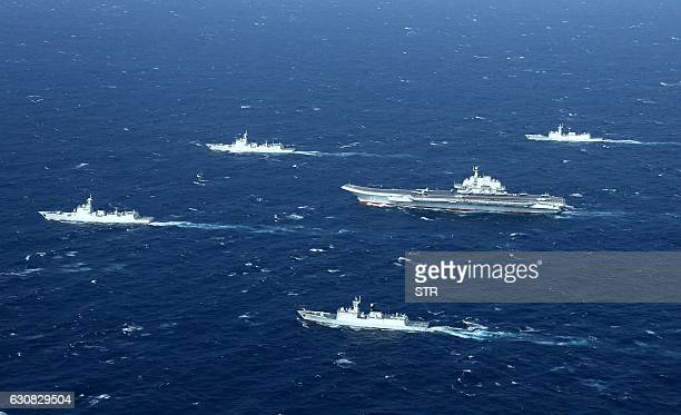 This aerial photo taken on January 2 2017 shows a Chinese navy formation including the aircraft carrier Liaoning during military drills in the South...