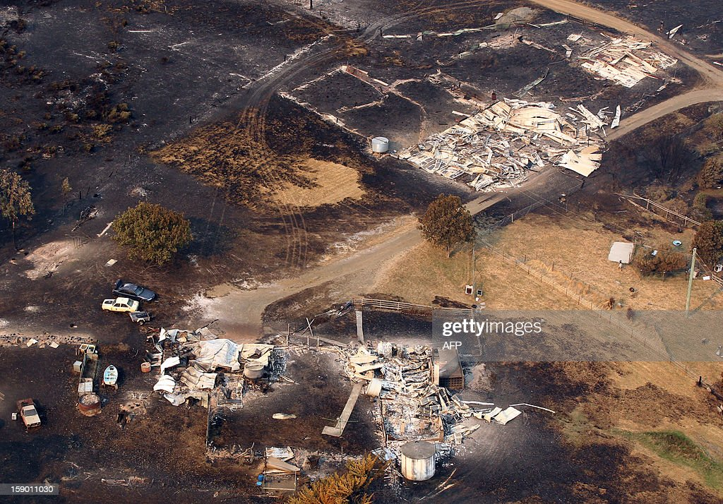 This aerial photograph taken on January 5, 2013 shows the devastation to property between Dunalley and Boomer Bay after bush fires swept through the area. Thousands of people have fled wildfires raging on the Australian island of Tasmania that have destroyed at least 80 properties amid fears that at least one man died in the blaze, police said. AFP PHOTO / POOL / Chris Kidd