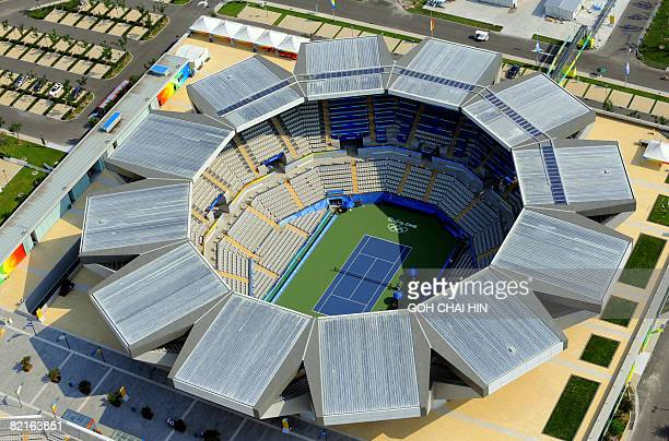 This aerial photos shows the tennis stadium for the Beijing 2008 Olympic Games in the Chinese capital on August 3 2008 Beijing basked under another...