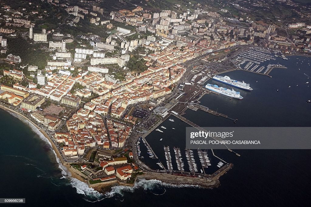 This aerial picture taken on February 13, 2016 shows the former SNCM ferry boat 'Jean Nicoli' () and the Meridionale company Ferry boat Girolata docked at Ajaccio's port, with trucks parked in front of its boarding ramps to avoid freight loading, on the French Mediterranean island of Corsica. / AFP / Pascal POCHARD-CASABIANCA