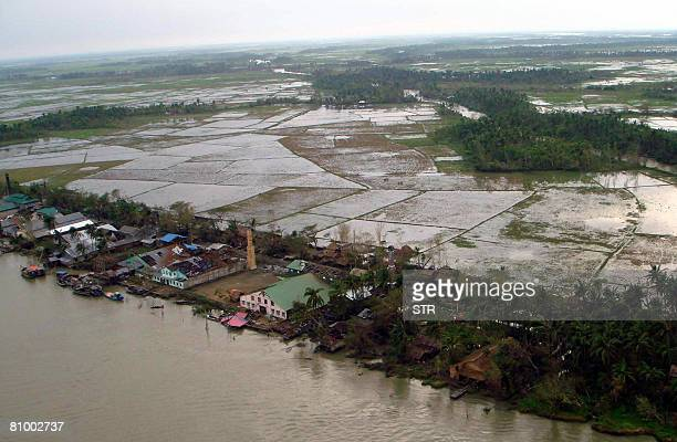 This aerial view shows a devastated factory with many roofs missing in a village in the Irrawaddy Delta region on May 5 2008 Myanmar's prodemocracy...