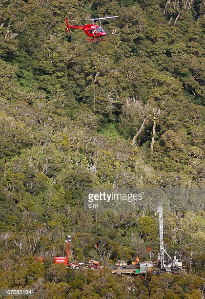 This aerial view shows a helicopter flying over the drilling rig at the Pike River Coal Mine some 50 kms from Greymouth on November 23 2010 where...