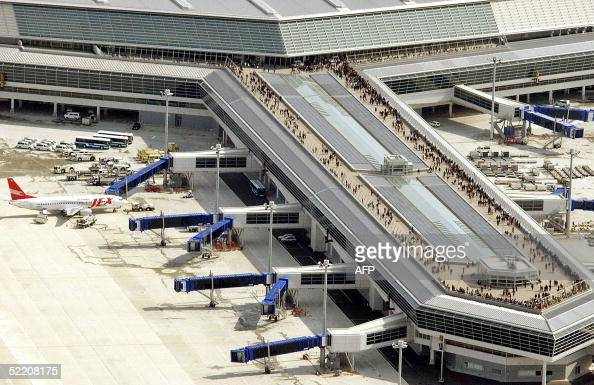 This aerial view shows crowds of people enjoy on the visitors's deck on the boarding bridge at the newly opened Centrair Japan International Airport...