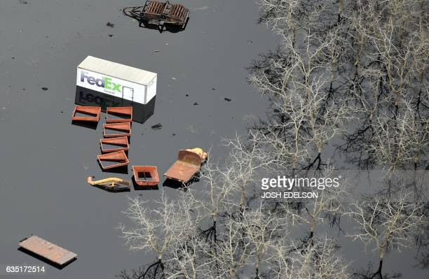 This aerial view shows submerged trucks and farm equipment in flowing water in Oroville California on February 13 2017 Almost 200000 people were...