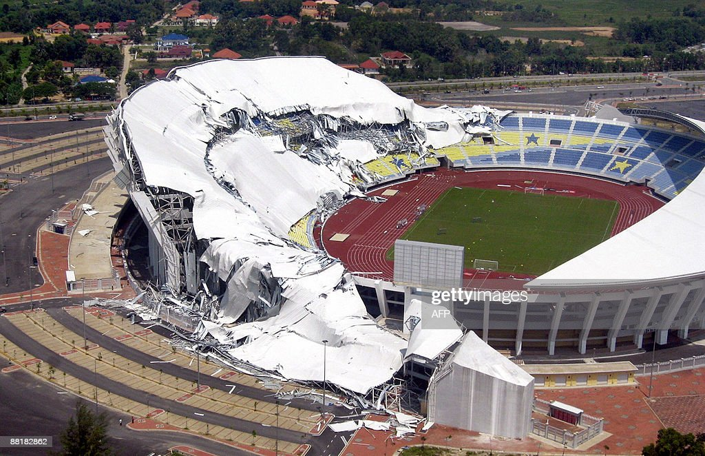 This aerial view shows the the collapsed half of roof of the Sultan Mizan Zainal Abidin Stadium in Kuala Terengganu on the eastern coast of...