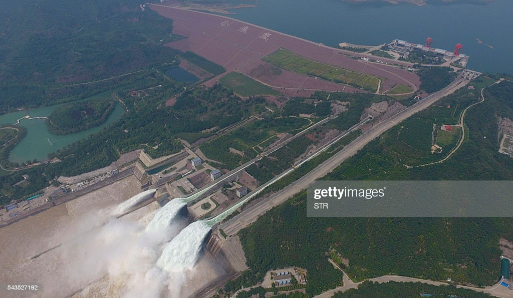 This aerial view shows water being released from the floodgates of the Xiaolangdi dam on the Yellow River near Luoyang, in China's Henan province on June 29, 2016. The floodgates are opened every year in an operation to flush millions of tonnes of silt from the river bed. / AFP / STR / China OUT