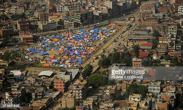 This aerial view taken from an Nepal army military helicopter shows a relief camp for earthquake survivors in Kathmandu on May 28 2015 More than 8600...