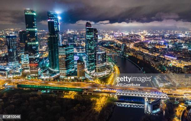 TOPSHOT This aerial view taken with a drone on November 5 2017 shows the Moscow City business district and the Moskva River / AFP PHOTO / DMITRY...