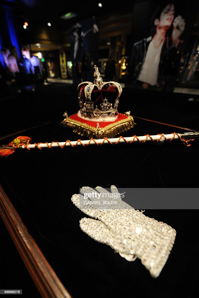 This April 13, 2009 file photo shows Michael Jackson's crown, ceremonial scepter and jewel-encrusted glove on display in Beverly Hills, California ahead of a cancelled sale of Michael Jackson memorabilia. Jackson died on June 25, 2009 after suffering a cardiac arrest, multiple US media outlets reported, sending shockwaves around the entertainment world. AFP PHOTO / Files / GABRIEL