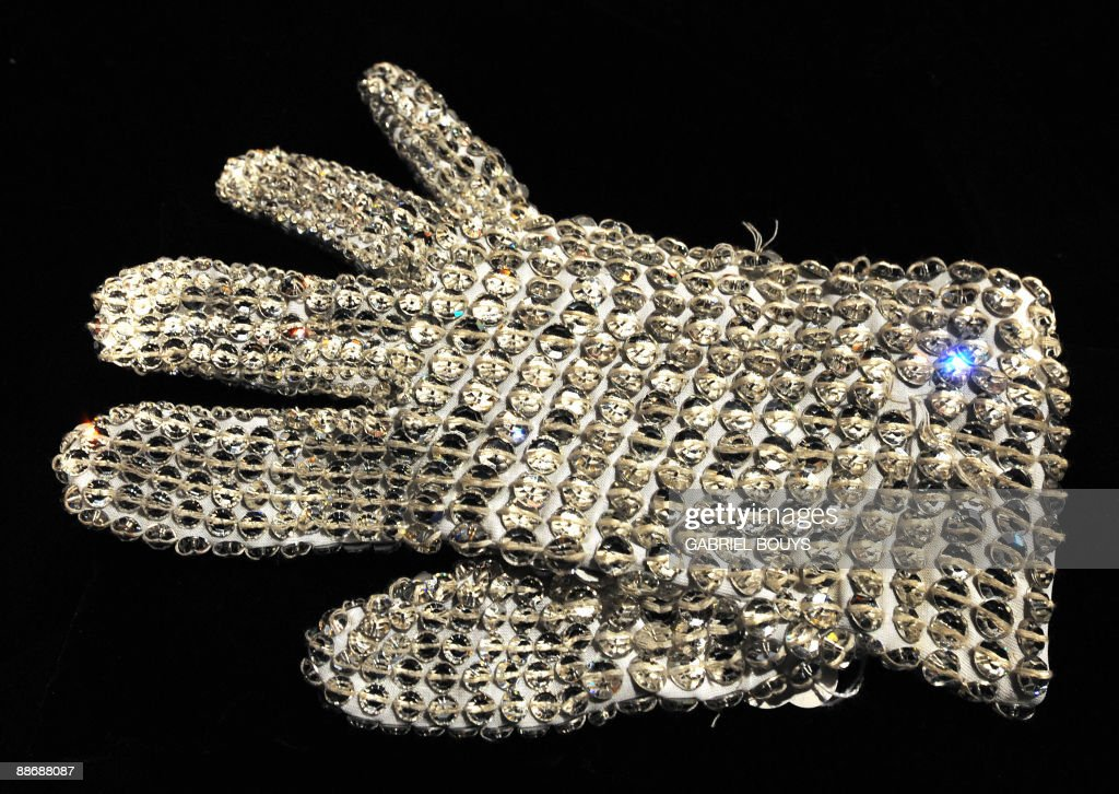 This April 13, 2009 file photo shows Michael Jackson's jewel-encrusted glove on display in Beverly Hills, California ahead of a cancelled sale of Michael Jackson memorabilia. Jackson died on June 25, 2009 after suffering a cardiac arrest, multiple US media outlets reported, sending shockwaves around the entertainment world. AFP PHOTO / Files / GABRIEL