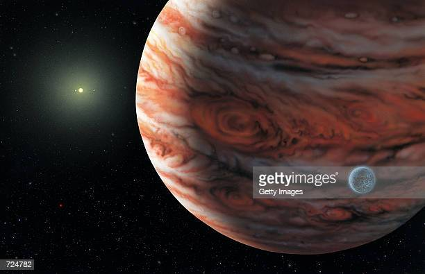 This artist's conceptual drawing released June 13 2002 depicts a Jupitermass planet orbiting the star 55 Cancri about 41 light years from Earth A...