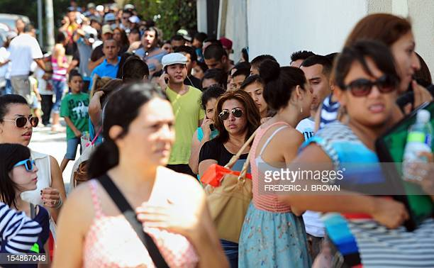 This August 15 2012 file photo shows a huge crowd forming a line around the block from the office of The Coalition for Humane Immigrant Rights of Los...