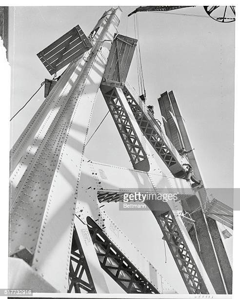 This beautiful picture is symbolic of the progress and construction aide possible under the PWA It shows a suspension tower for the Davenport Iowa...