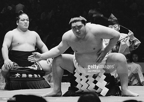 This black and while picture taken in 1966 shows 'yokozuna' Taiho performing an entrance into the ring ceremony during a tournament in Tokyo Japan...
