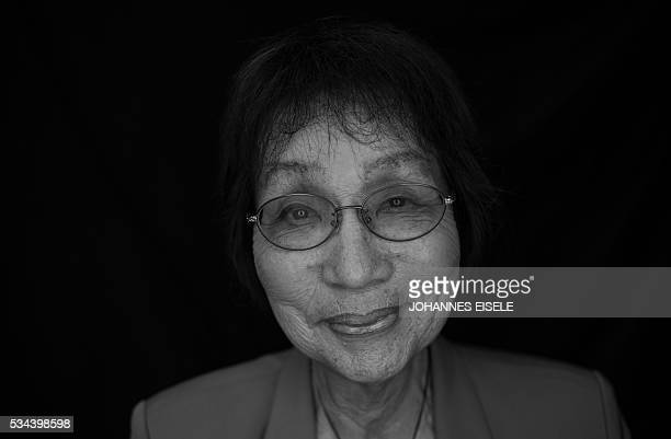 This black and white picture taken on May 25 2016 shows Emiko Okada a survivor of the atomic bombing of Hiroshima posing for a picture at the...