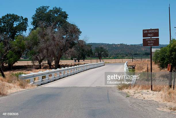 This bridge near Parkfield Ca crosses the San Andreas fault The bridge is crooked due to earth movement along the fault line The Pacific plate on the...