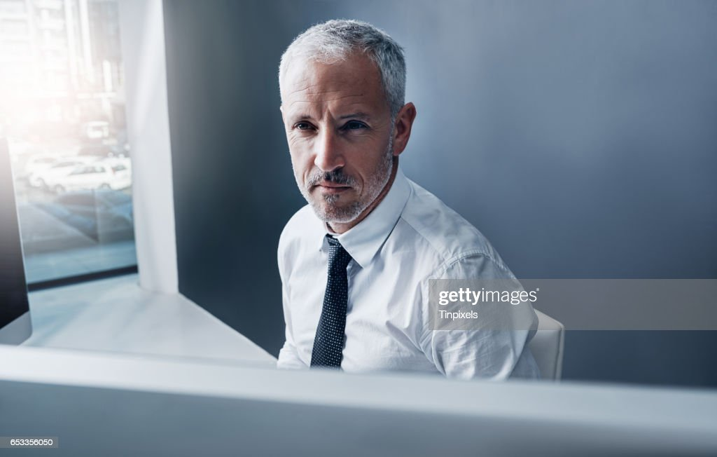 This businessman moves with the times : Stockfoto
