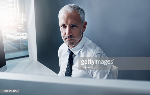 This businessman moves with the times : Stock Photo
