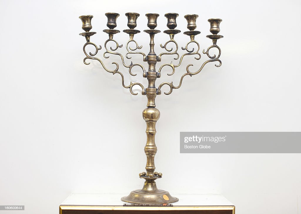 This candelabra is one of the items for sale. Ed Gurwitch, a longtime member of Temple Beth El in Quincy, Mass. is the man working to have his synagogue's stained glass windows, Biblical texts, and other art works appraised and offered for sale with all proceeds to go to a charitable endowment. Soon the building will be sold and members are desperate to be sure such holy items are provided for.