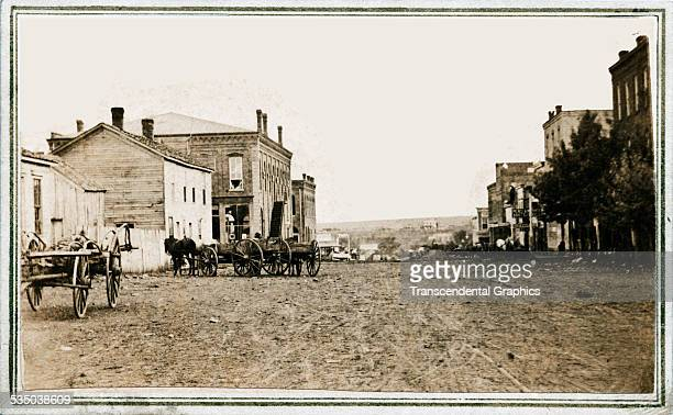 This cartedevisite photo shows a view looking down Wall St from the corner of Jones St in Fort Scott Kansas circa 1865