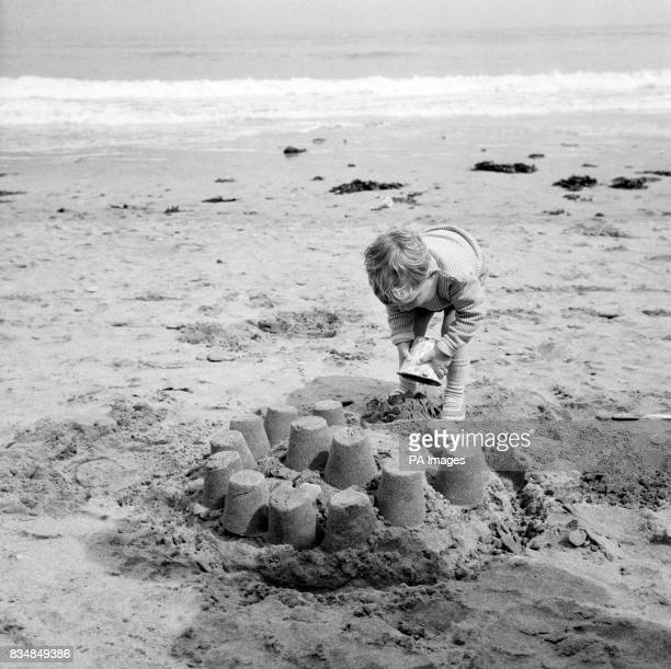 This child enjoys his Cornish holiday as he builds sandcastles on the oilfree beach at St Ives Most of the beaches which suffered from the oil that...