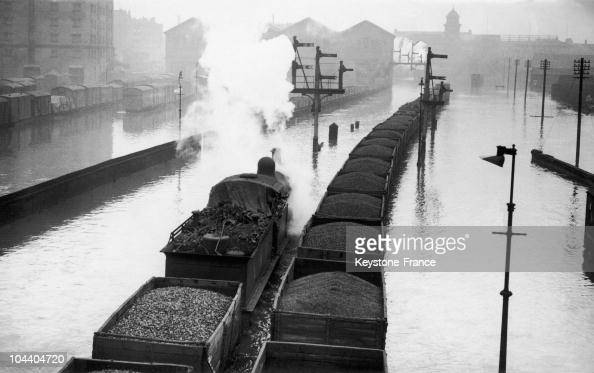 This coal train near Nottingham is going through the train sidings flooded by the rising of the nearby river