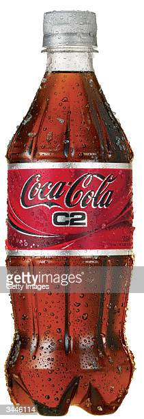This CocaCola handout photo Coke's newest product C2 stands on display The new cola has half the sugar carbohydrates and calories of regular soft...