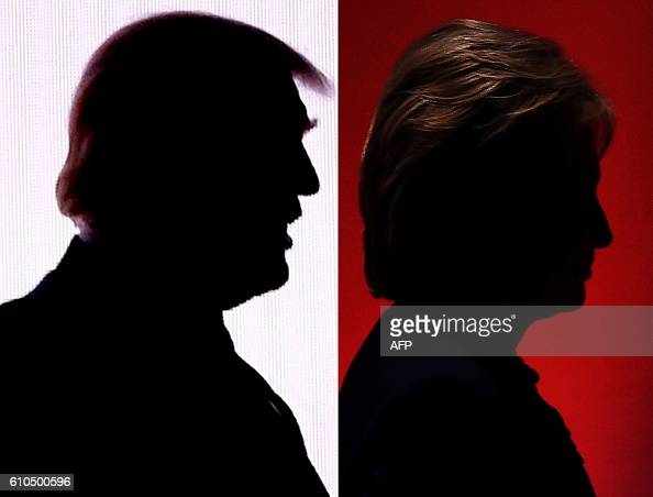 TOPSHOT This combination of file photos shows the silhouettes of Republican presidential nominee Donald TrumpJuly 18 2016 and Democratic presidential...