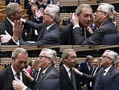 TOPSHOT This combination of pictures created on June 28 2016 shows United Kingdom Independence Party leader Nigel Farage reacting as he meets with...