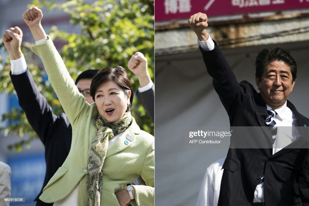 Japanese Premier Shinzo Abe and Tokyo Governor Yuriko Koike campaign for Sunday's elections of the world 3rd-biggest economy