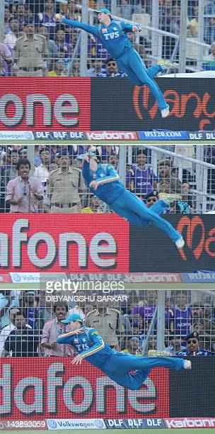 This combination of three photographs show Pune Warriors India fielder Steve Smith attempting a catch at the boundary line during the IPL Twenty20...