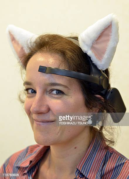 This combo of pictures taken on May 24 2011 shows an AFP journalist wearing a headset with cat ears called 'Necomimi' which can be cotrolled by a BMI...