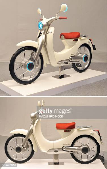 This combo photo shows Honda Motor's concept model the EVCub electric motorcycle for the upcoming Tokyo Motor Show at a press preview in Tokyo on...