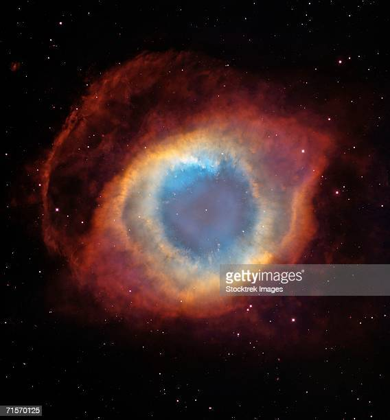 This composite image is a view of the colorful Helix Nebula taken with the Advanced Camera for Surveys aboard NASA's Hubble Space Telescope and the Mosaic II Camera on the 4-meter telescope at Cerro Tololo Inter-American Observatory in Chile.