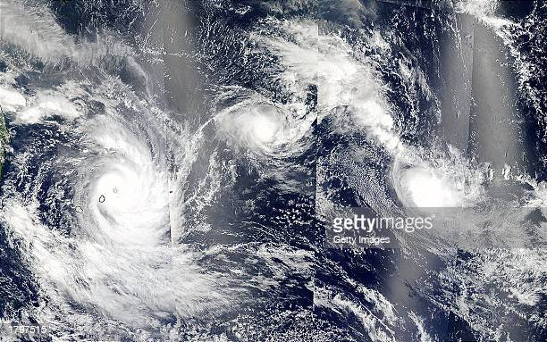 This composite satellite image shows three cyclones east of Madagascar on February 13 2003 in the Indian Ocean The image combines several separate...