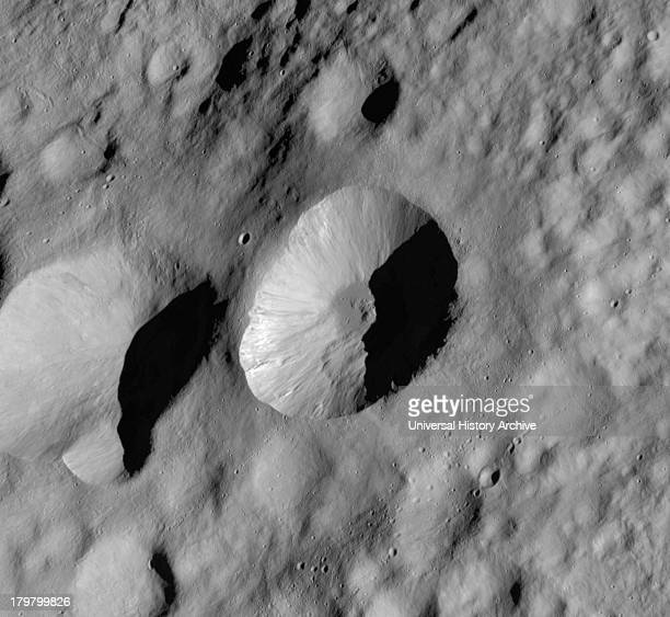 This Dawn framing camera image of Asteroid Vesta shows Licinia crater which is the large crater in the center of the image Licinia has a fresh sharp...
